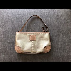 Coach gold metallic/tan leather trimmed wristlet